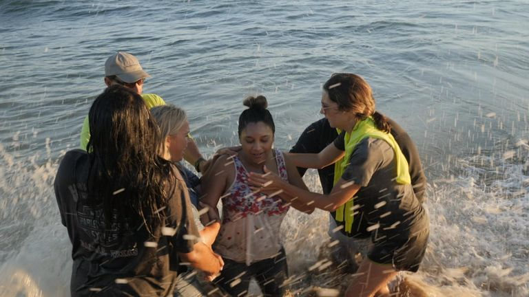 US group called Saturate OC has been holding religious revivals and baptisms on beaches along the coastline of Orange County in Southern California