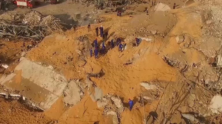 Russian aid teams dig for survivors in rubble