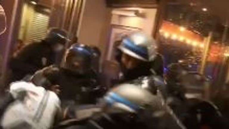Riot police in Paris after watching a football game got out of hand