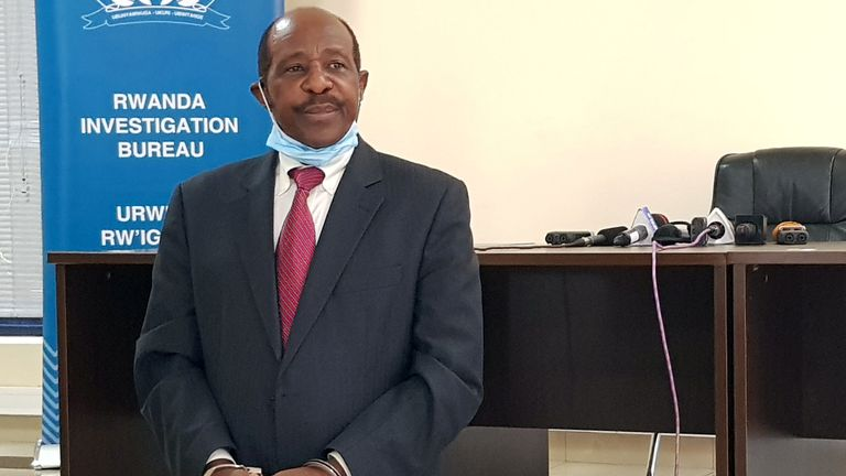 Paul Rusesabagina was paraded in handcuffs before the media at police headquarters