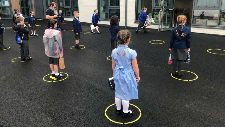 Upon arrival, each student at Tollbrae Primary School is asked to stand on  colour painted in circles on the tarmac.
