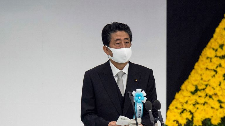 Japanese Prime Minister Shinzo Abe delivers a speech during a memorial service in Tokyo