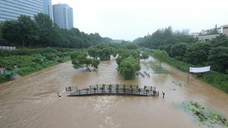 A trail alongside Yangjae Stream is flooded due to heavy rain in Seoul, South Korea, 09 August 2020.