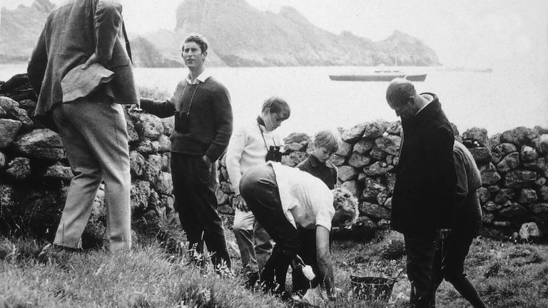 Undated handout photo issued by the National Trust for Scotland of the Prince of Wales (2nd left) on St Kilda in 1971, he has replied to a postcard, which was written to him by NTS Western Isles manager Susan Bain in letters posted in 2010 in a small handcrafted mailboat to mark 80 years since the evacuation of the remote islands and have been found by children in Norway.