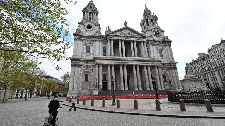 The entrance to St Paul's Cathedral is seen fenced off as tourists stay away on the bank holiday Monday in London on April 13, 2020