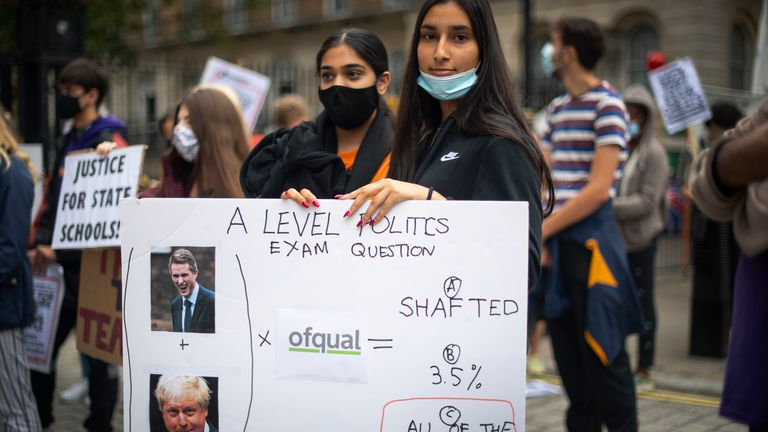 Students take part in a protest in Westminster in London over the government's handling of A-level results