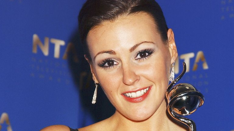"Coronation Street actress Suranne Jones poses in the Awards Room with the award for Best Actress at the ""10th Anniversary National Television Awards"" at the Royal Albert Hall on October 26, 2004 in London"