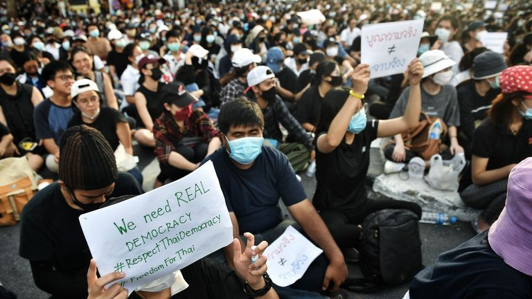Anti-government protesters hold up signs during a rally at Democracy Monument in Bangkok on August 16, 2020. - Protesters gathered for a rally in Bangkok on August 16 against the government as tensions rose in the kingdom after the arrest of three activists leading the pro-democracy movement. (Photo by Lillian SUWANRUMPHA / AFP) (Photo by LILLIAN SUWANRUMPHA/AFP via Getty Images)