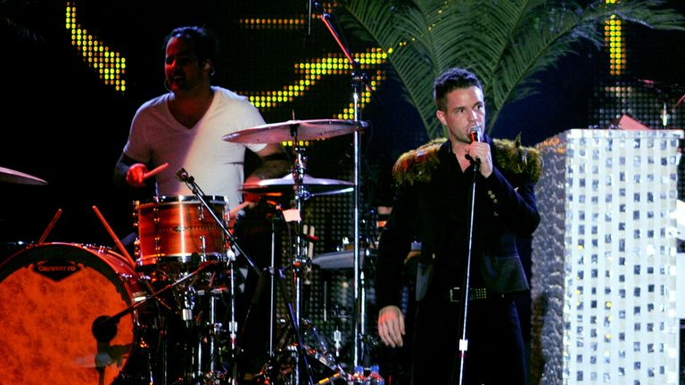 Ronnie Vannucci Jr (L) and Brandon Flowers of The Killers perform as part of Lollapalooza 2009 at Grant Park on August 9, 2009 in Chicago, Illinois