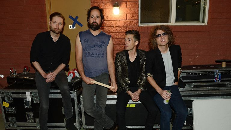 The Killers (L-R) bass guitarist Mark Stoermer, drummer Ronnie Vannucci Jr., singer Brandon Flowers and guitarist Dave Keuning pose at Bunkhouse on April 7, 2016 in Las Vegas, Nevada
