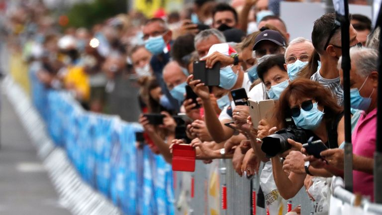 Cycling - La Course by Tour de France - Nice, France - August 29, 2020. Fans wearing protective face masks take pictures at the start. REUTERS/Stephane Mahe