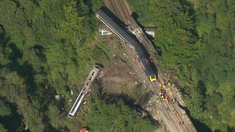Aerial shots appear to show one of the carriages on its side
