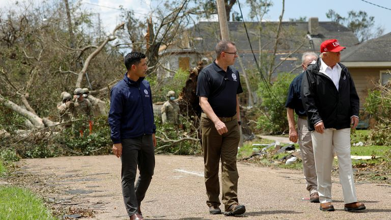 U.S. President Donald Trump accompanied by Department of Homeland Security (DHS) Secretary Chad Wolf and Federal Emergency Management Agency (FEMA) Administrator Pete Gaynor are seen during a visit to areas damaged by Hurricane Laura in Lake Charles, Louisiana, U.S., August 29, 2020. REUTERS/Tom Brenner