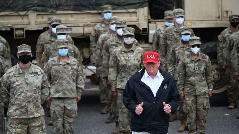US President Donald Trump poses with National Guard troops in Lake Charles, Louisiana, on August 29, 2020. Trump surveyed damage in the area caused by Hurricane Laura. - At least 15 people were killed after Laura slammed into the southern US states of Louisiana and Texas, authorities and local media said on August 28. (Photo by ROBERTO SCHMIDT / AFP) (Photo by ROBERTO SCHMIDT/AFP via Getty Images)