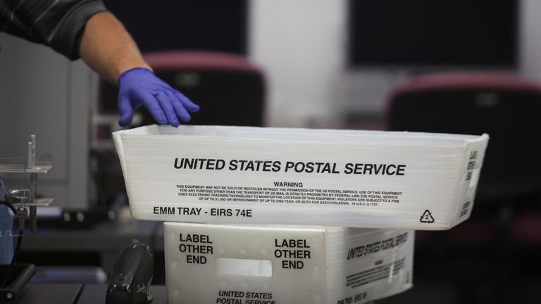 A US Postal Service basket with mail-in ballots in Florida in August