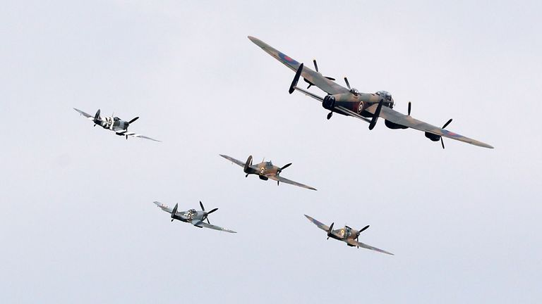 A Lancaster bomber, three Spitfires and a Hurricane perform a fly-past over the National Memorial Aroboretum on the 75th anniversary of VJ Day
