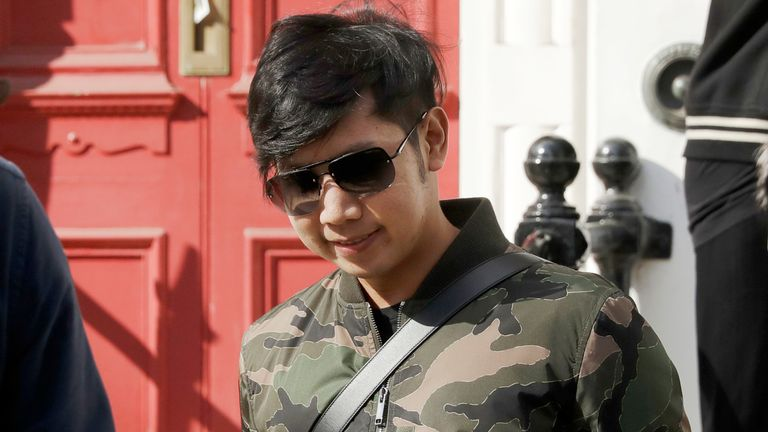 """FILE - In this April 5, 2017, file photo, Vorayuth """"Boss"""" Yoovidhya, whose grandfather co-founded energy drink company Red Bull, walks to get in a car as he leaves a house in London. With the clock about to run out on a hit-and-run charge, the whereabouts of an heir to the Red Bull energy-drink empire accused of killing a Bangkok police officer five years ago are unknown. The fugitive, whose family is worth billions, has apparently found a way to disappear. (AP Photo/Matt Dunham, File)"""