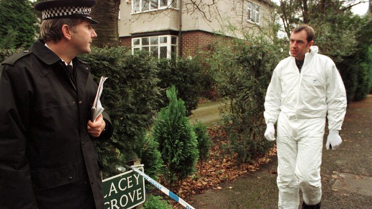 Police forensic team outside Lacey Grove, Wilmslow, Cheshire, where Donald Leslie Ward and his wife Auriel were found murdered. A murder inquiry was under way after the elderly couple were found to have died from multiple injuries, including stab wounds