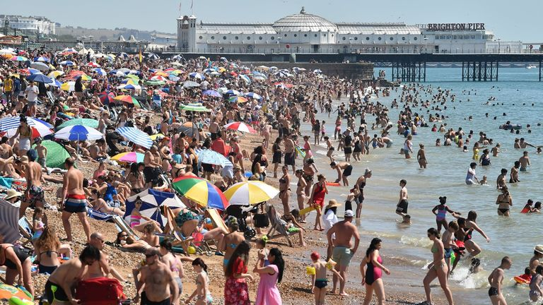 Crowds descended onto Brighton beach in the hot temperatures