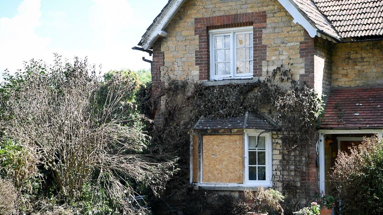 The house in Derry Hill near Calne has been boarded up