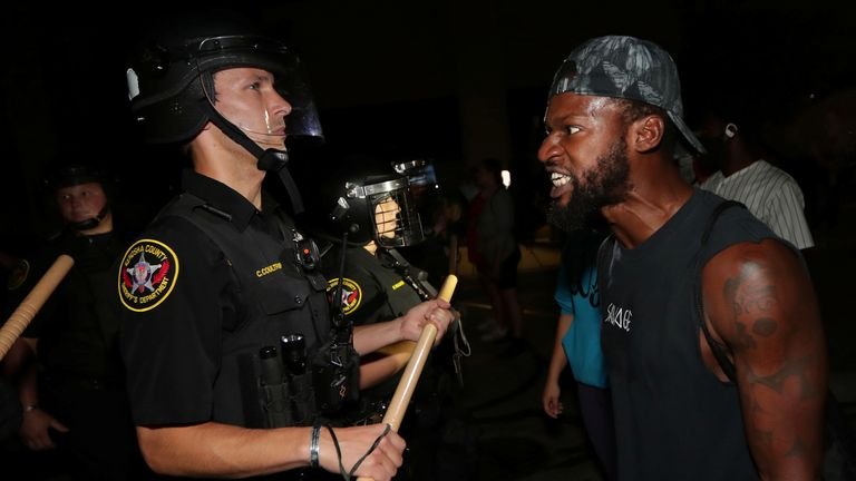 A man confronts police outside the Kenosha Police Department in Kenosha, Wisconsin, U.S., during protests following the police shooting of Black man Jacob Blake August 23, 2020. Picture taken August 23, 2020. Mike De Sisti/Milwaukee Journal Sentinel via USA TODAY via REUTERS MANDATORY CREDIT