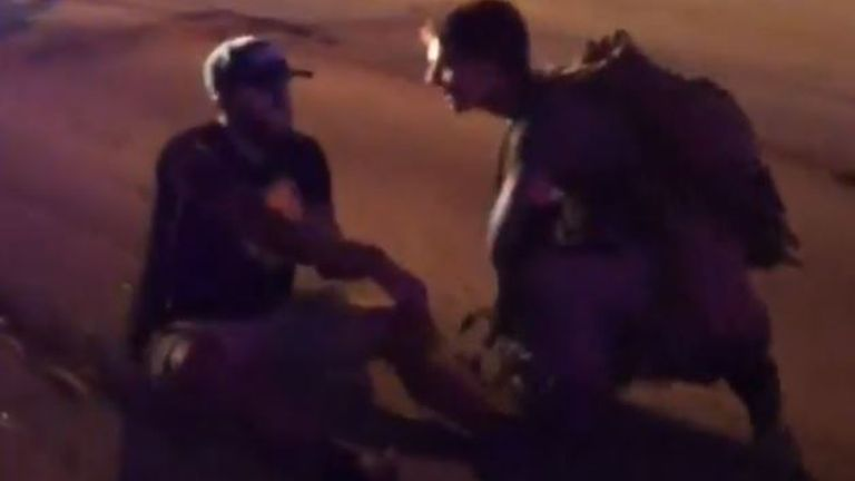 Man struggles with wounded arm during Wisconsin protests