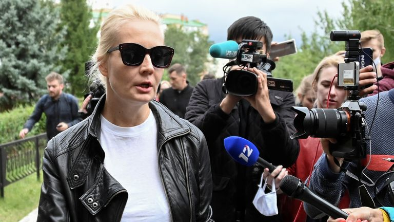 Yulia Navalnaya, wife of Russian opposition leader Alexei Navalny, speaks with the media outside a hospital, where Alexei receives medical treatment in Omsk, Russia August 21, 2020. Alexei Navalny began feeling ill, en route from Tomsk to Moscow, on a plane which made an emergency landing in Omsk due to his serious condition. REUTERS/Alexey Malgavko