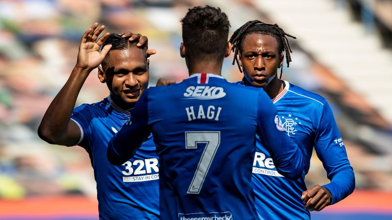 Alfredo Morelos celebrates after his shot was turned into the net by Conor McCarthy