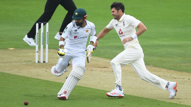 SOUTHAMPTON, ENGLAND - AUGUST 14: James Anderson of England looks to field the ball from his own bowling as Mohammad Rizwan of Pakistan runs a single during Day Two of the 2nd #RaiseTheBat Test Match between England and Pakistan at the Ageas Bowl on August 14, 2020