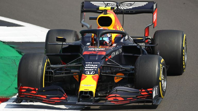 Max Verstappen overtakes Valtteri Bottas for the race lead during the 70th Anniversary Grand Prix