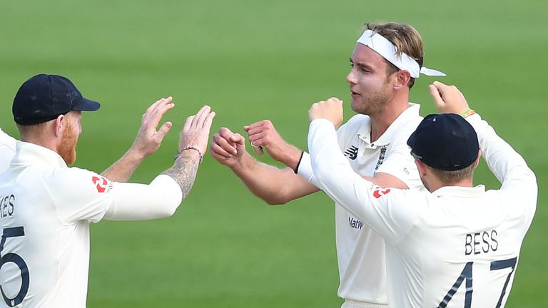 MANCHESTER, ENGLAND - AUGUST 07: Stuart Broad of England celebrates with Ben Stokes and Dom Bess after taking the wicket of Shan Masood of Pakistan during Day Three of the 1st #RaiseTheBat Test Match between England and Pakistan at Emirates Old Trafford on August 07, 2020 i