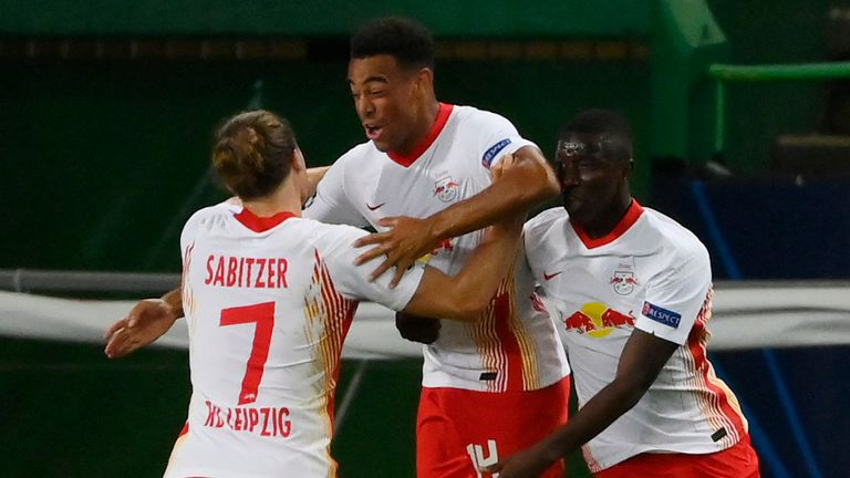 RB Leipzig's Tyler Adams celebrates with team-mates after scoring against Atletico Madrid