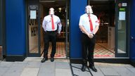 Bouncers wearing visors secure the entrance to a pub in Newcastle, northern England on July 4, 2020, as restrictions are further eased during the novel coronavirus COVID-19 pandemic. - Pubs in England reopen on Saturday for the first time since late March, bringing cheer to drinkers and the industry but fears of public disorder and fresh coronavirus cases. (Photo by Lindsey Parnaby / AFP) (Photo by LINDSEY PARNABY/AFP via Getty