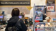 A customer is served at Greggs in Leeds