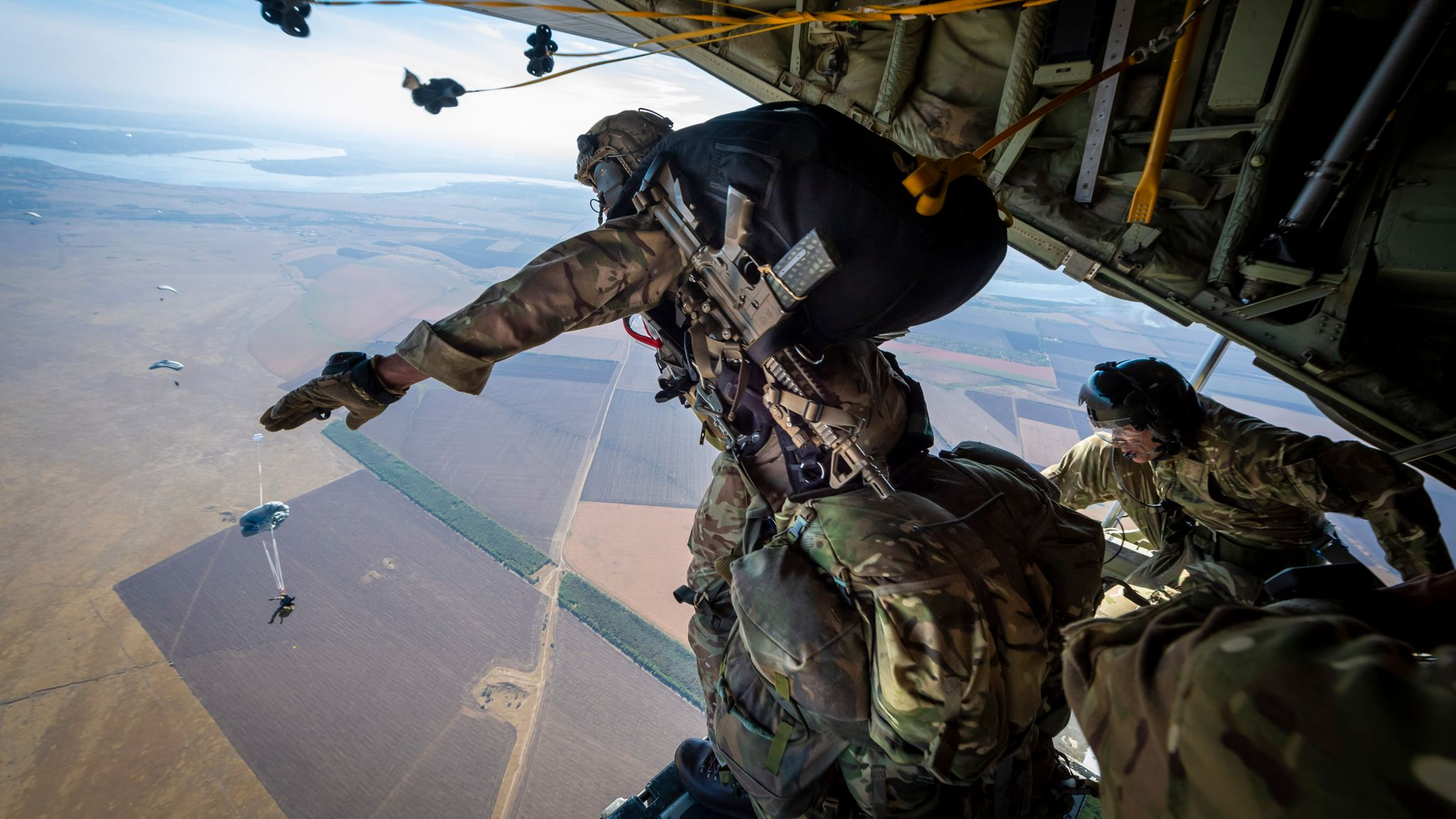 British troops perform largest parachute drop for decades 'to show  solidarity' with Ukraine   UK News   Sky News