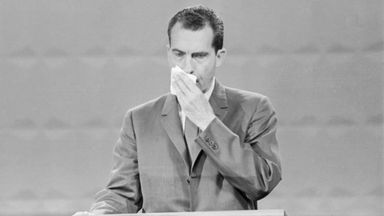 Richard Nixon wipes his brow during the first televised debate against John F Kennedy