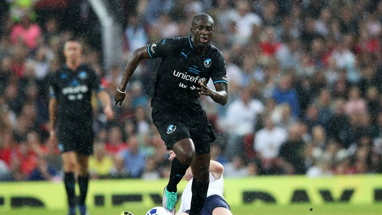 MANCHESTER, ENGLAND - JUNE 10: Damian Lewis and Yaya Toure fight for the ball during the Soccer Aid for UNICEF 2018 match between England and The Rest of the World at Old Trafford on June 10, 2018 in Manchester, England. (Photo by Lynne Cameron/Getty Images)