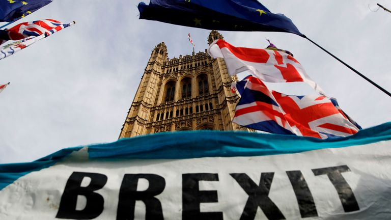 TOPSHOT - A pro-Brexit banner is seen outside the Houses of Parliament in London on October 30. 2019. - Britain's political leaders tested their election pitches today after parliament backed Prime Minister Boris Johnson's bid for a pre-Christmas poll aimed at breaking the years-long Brexit impasse. (Photo by Tolga AKMEN / AFP) (Photo by TOLGA AKMEN/AFP via Getty Images)