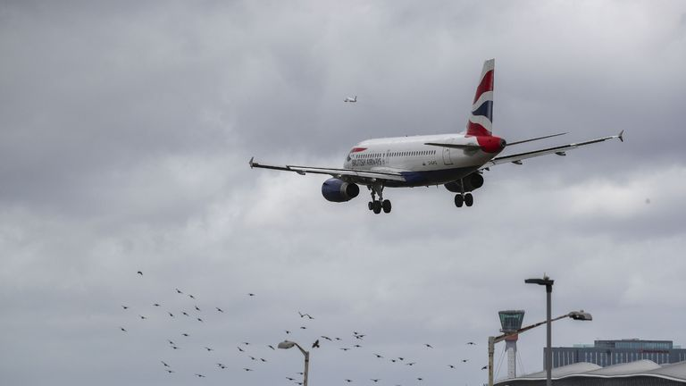 A British Airways plane lands in the strong winds at Heathrow airport, as storm Francis hits the UK.
