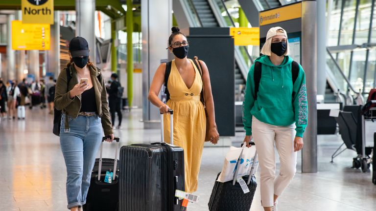 (left to right) Alex Parr, Carmen Jones and Neringa Juskauskaite who have arrived in from Pula, Croatia to London Heathrow Airport and now how to self isolate for 14 days.