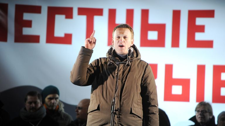 One of the protest movement leaders, Alexei Navalny, addresses the opposition rally to demand fair elections at the Pushkinskaya Square in central Moscow, March 5, 2012. Some 5,500 people were gathering today in Moscow for the first major opposition rally after Vladimir Putin's crushing victory in Russian presidential elections, police in the capital said. AFP PHOTO / NATALIA KOLESNIKOVA (Photo by Natalia KOLESNIKOVA / AFP) (Photo by NATALIA KOLESNIKOVA/AFP via Getty Images)