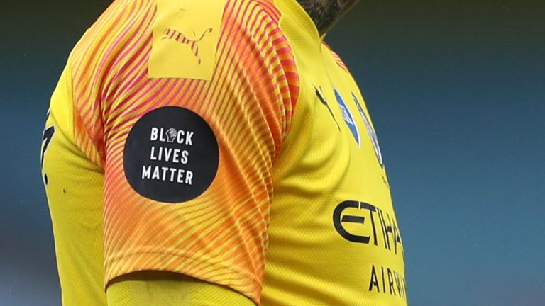 The black lives matter badge can be seen on the shirt of Manchester City goalkeeper Ederson during the Premier League match at the Etihad Stadium, Manchester.