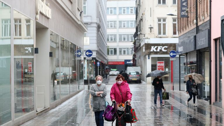 File photo dated 12/06/20 of shoppers in Belfast after all shopping centres and retailers were given the green light to reopen in a significant relaxation of coronavirus lockdown restrictions in Northern Ireland. People living alone will be reunited with their families on Saturday after three months of coronavirus lockdown in Northern Ireland.