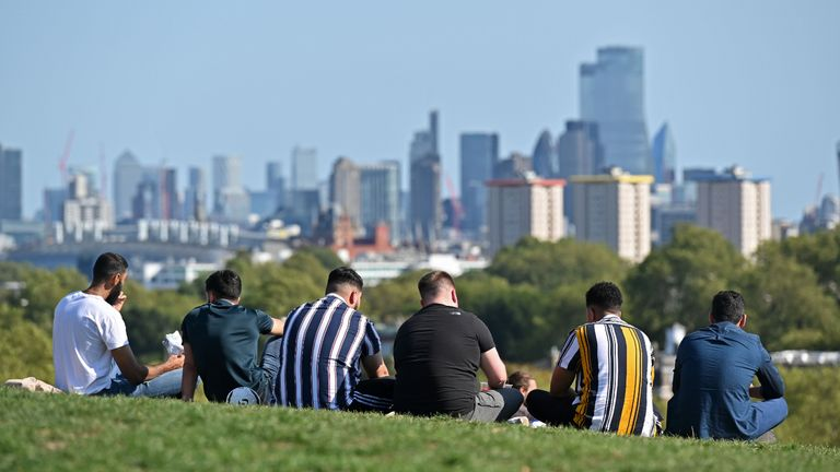 "People gather on Primrose Hill in central London in the late summer sunshine on September 13, 2020, the day before the UK government brings in tightened coronavirus restrictions owing to a sharp rise in cases nationwide. - The new ""rule of six"" in England will replace a raft of ""complicated and confusing"" regulations and help reverse the upward trend of infections. (Photo by JUSTIN TALLIS / AFP) (Photo by JUSTIN TALLIS/AFP via Getty Images)"