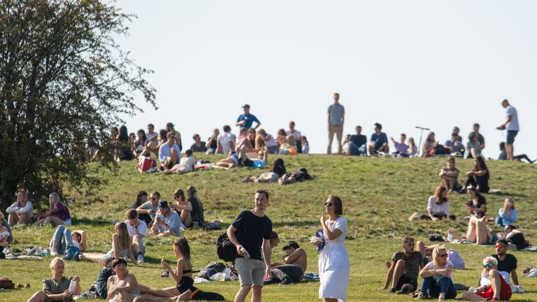 """People enjoying the Autumn sunshine on Primrose Hill, London. The public has been urged to act """"in tune"""" with Covid-19 guidelines before the """"rule of six"""" restrictions come into force on Monday."""