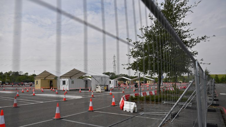 """A coronavirus COVID-19 testing centre is pictured in a car park at Ebbsfleet International Railway Station, in Ebbsfleet, south east of London, on April 27, 2020. - Prime Minister Boris Johnson on Monday made his first public appearance since being hospitalised with coronavirus three weeks ago, saying Britain was beginning to """"turn the tide"""" on the outbreak but rejecting calls to ease a nationwide lockdown. (Photo by Ben STANSALL / AFP) (Photo by BEN STANSALL/AFP via Getty Images)"""