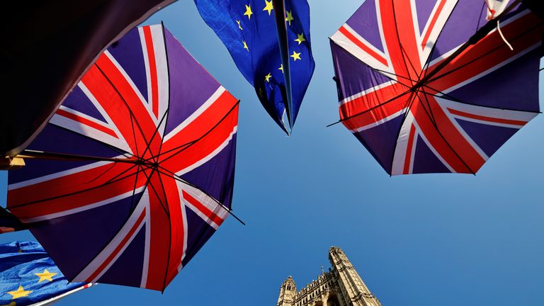 EU flag and Union flag-themed umbrellas of Brexit activists fly outside the Houses of Parliament in London on October 22, 2019, as MPs begin debating the second reading of the Government's European Union (Withdrawal Agreement) Bill. - British Prime Minister Boris Johnson faces two crucial Brexit votes Tuesday that could decide if he still has a reasonable shot at securing his EU divorce by next week's deadline. The UK is entering a cliffhanger finale to a drama that has divided families and embittered politics ever since voters backed a split from Britain's 27 EU allies and trading partners in 2016. (Photo by Tolga Akmen / AFP) (Photo by TOLGA AKMEN/AFP via Getty Images)