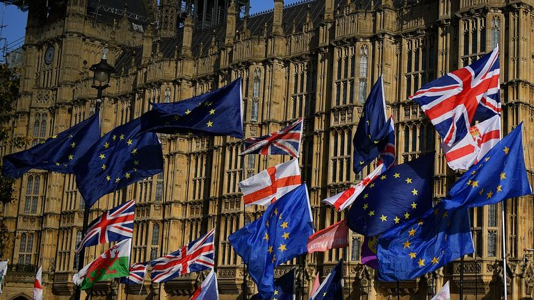 EU and Union flags belonging to both anti-Brexit and pro-Brexit activists, fly outside the Houses of Parliament in London on October 22, 2019, as MPs begin debating the second reading of the Government's European Union (Withdrawal Agreement) Bill. - British Prime Minister Boris Johnson faces two crucial Brexit votes Tuesday that could decide if he still has a reasonable shot at securing his EU divorce by next week's deadline. The UK is entering a cliffhanger finale to a drama that has divided families and embittered politics ever since voters backed a split from Britain's 27 EU allies and trading partners in 2016. (Photo by DANIEL LEAL-OLIVAS / AFP) (Photo by DANIEL LEAL-OLIVAS/AFP via Getty Images)
