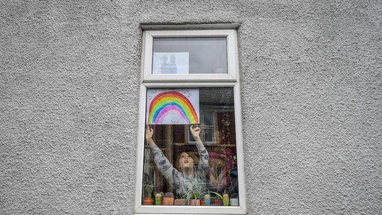 File photo dated 1/4/2020 of Jack Tucker, seven, placing his rainbow in the window of a house in Bedminster, Bristol. Wednesday marks 100 days since first full day of UK lockdown and six months since China alerted WHO to Wuhan cases.