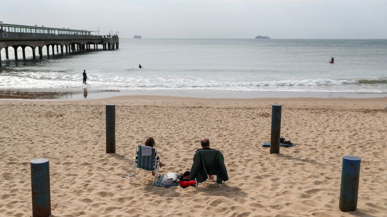 People on the beach at Boscombe in Dorset, the Met Office forecasts a weekend of largely dry, bright and fine weather, which could see temperatures rise as high as 24C (75F).